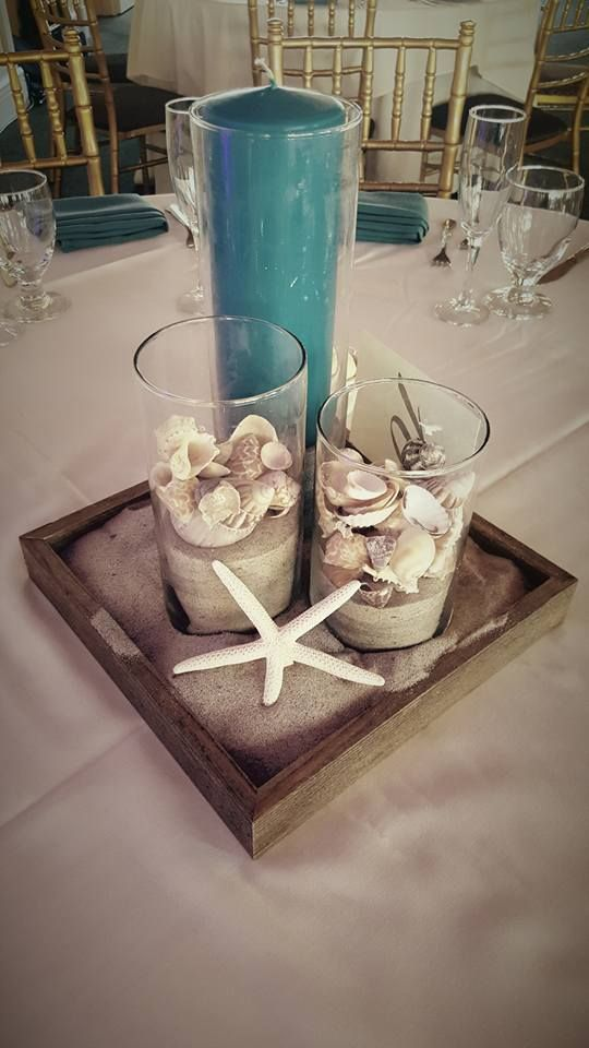 Beach themed centerpieces for weddings 1000 ideas about beach wedding centerpieces on emasscraft org junglespirit Image collections