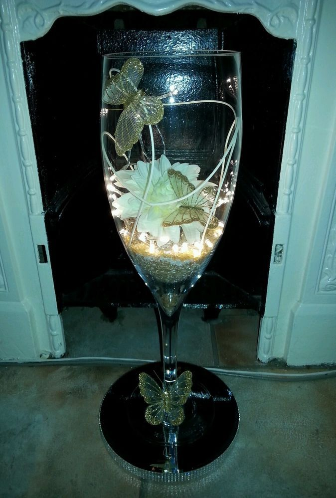 Large champagne glass centerpieces for weddings