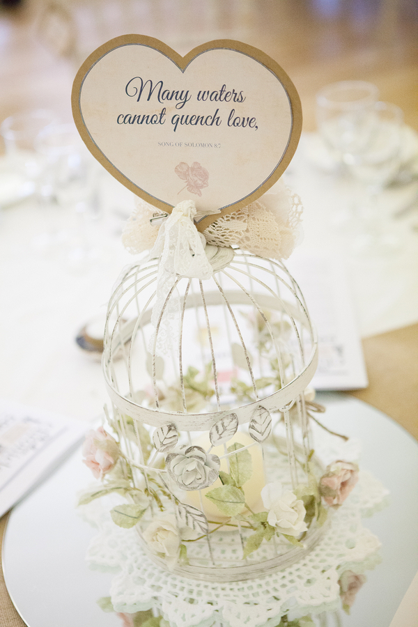 The Centerpieces Featured Vintage Birdcages Decorated With Flowers
