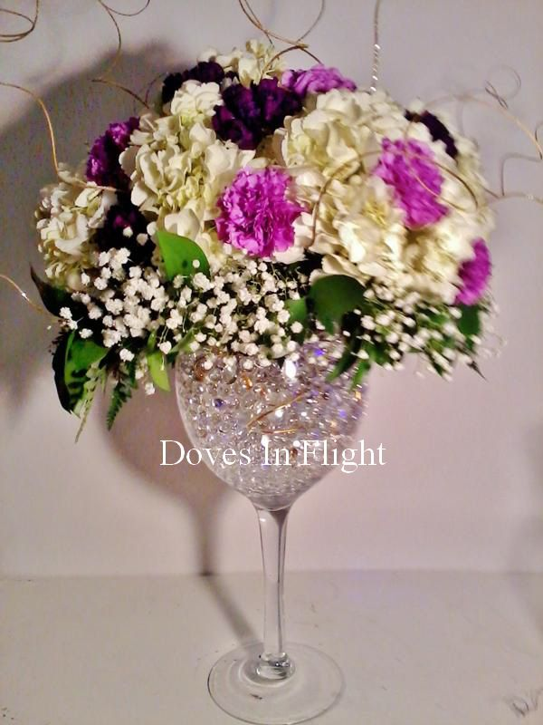 Goblet wedding centerpieces for Centerpieces made with wine glasses