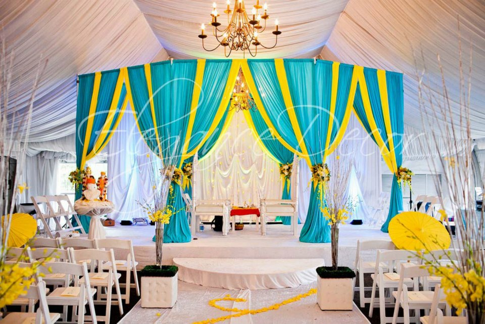 Yellow wedding decorations turquoise yellow fabric mandap by elegance decor chicago best green and yellow wedding junglespirit Image collections